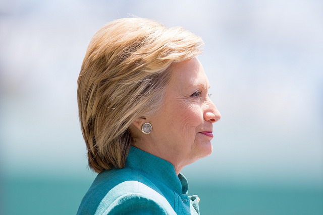 image of Hillary Clinton in profile; she is slightly smiling
