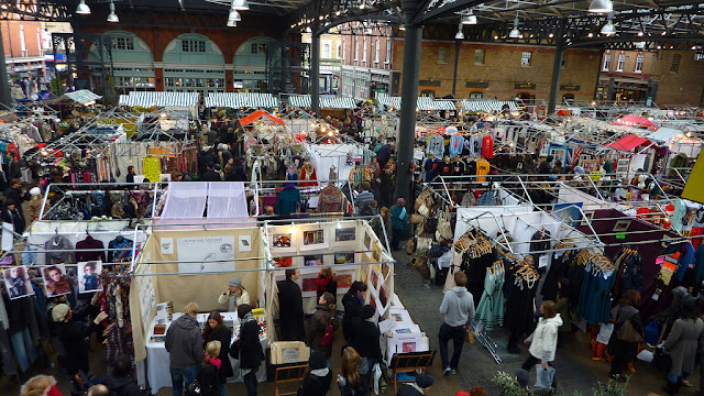 A high view over some of the stalls in Spitalfields market London