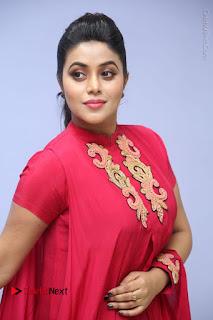 Actress Poorna Latest Stills in Red Dress at Rakshasi First Look Launch  0165.JPG