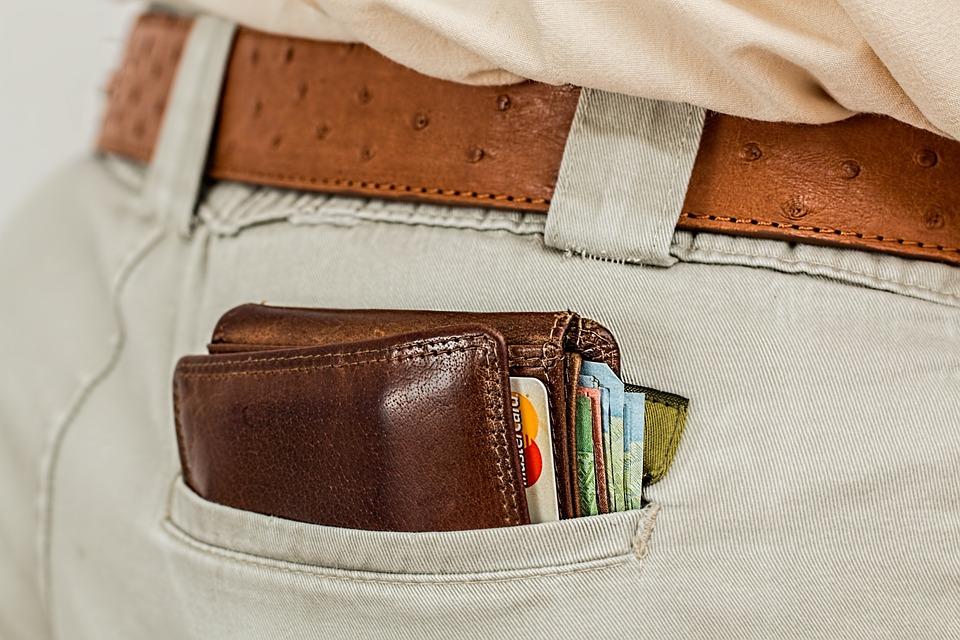 brown wallet in a mans pant