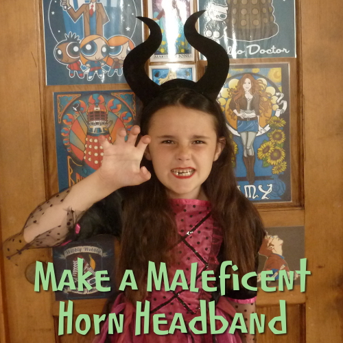Girl wearing a black DIY horn headband see the craft tutorial