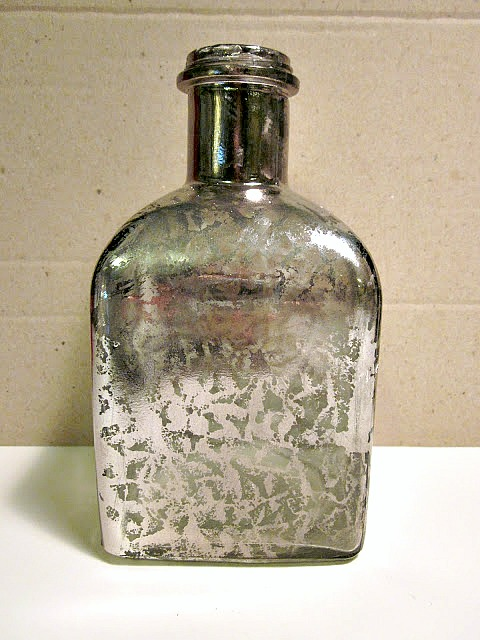 Repurposed Mercury Glass Bottle.