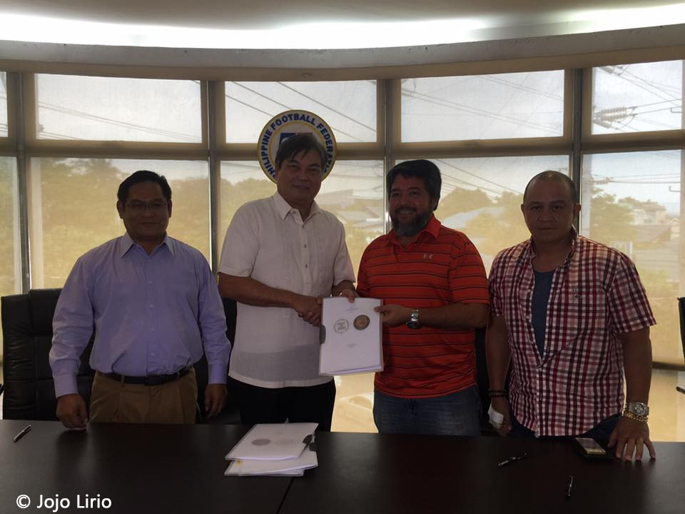 Stallion Laguna co-owner Filbert Alquiros shakes hands with PFF President Mariano Araneta after signing the franchise agreement.