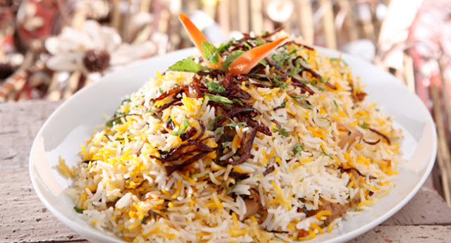 Your kid often gets bored with the same old mundane foods and keeps nagging for a spicy t Chicken Biryani Recipe - How to Make Chicken Biryani