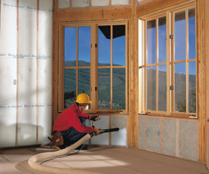man insulating walls