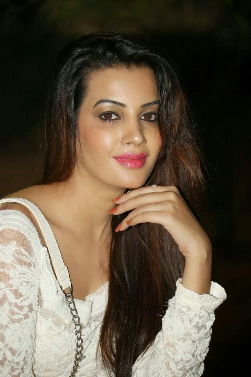 Diksha Panth Photo Gallery with no Watermarks, Actress Diksha Panth Crossleg Sitting Pics in White Dress from Event