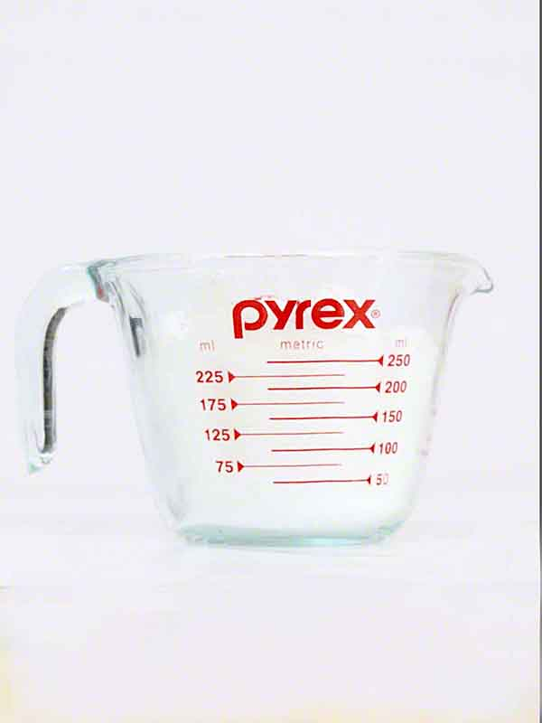 Pyrex measuring cup, glass, Epsom salt