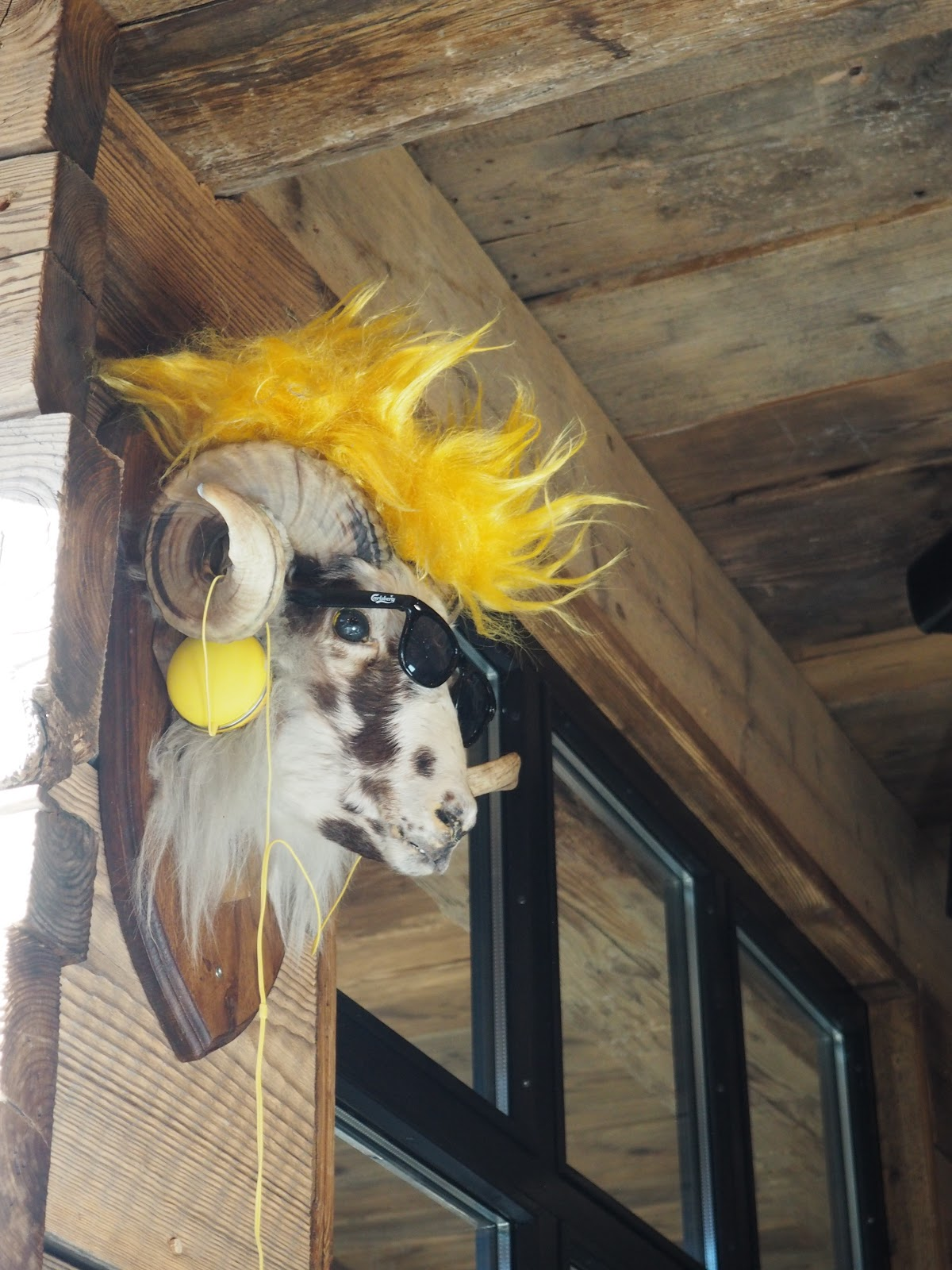 mountain goat wearing a wig La Baraque interior in Val d'isere, France