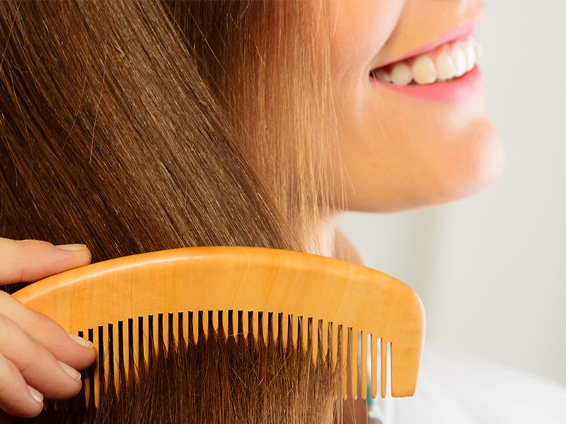 Use a wide tooth wood comb