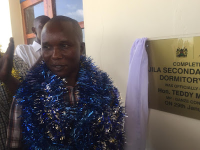 Hon. Teddy Mwambire opening Dormitory at Jila Secondary school. PHOTO Courtesy