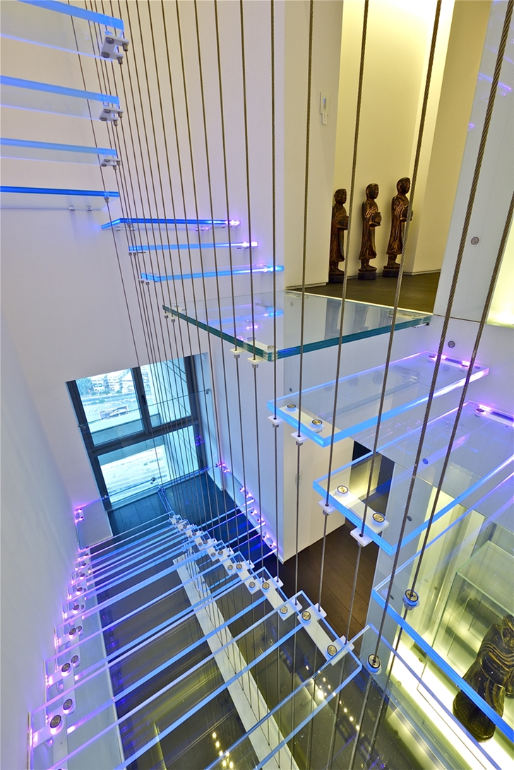 Glass staircase in penthouse