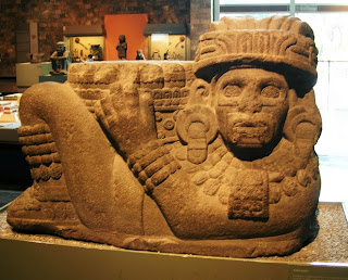 Chac Mool, holding a pillar like object emerging from his stomach. National Museum of Anthropology in Mexico City