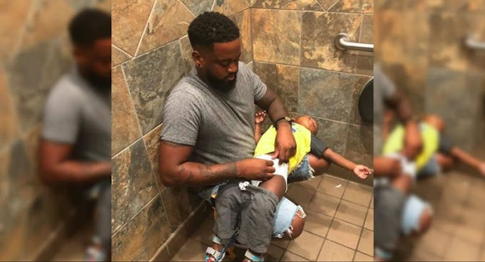 Photo of Dad Changing His Son's Diaper On His Lap In Public Restroom Goes Viral