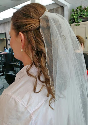 pulled back curled bridal hairstyle