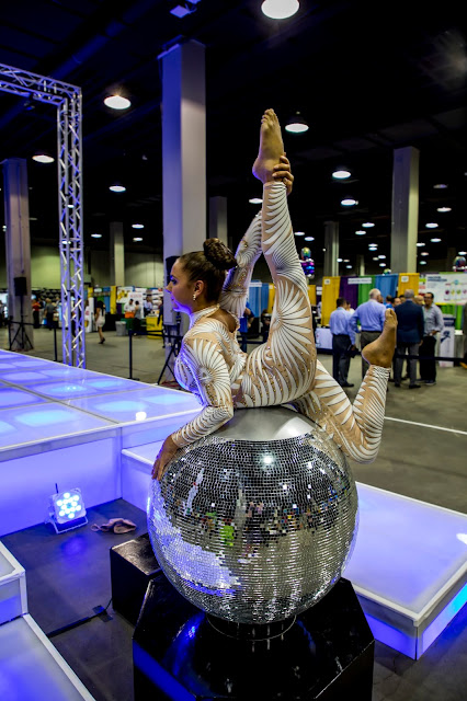 contortionist, disco ball, entertainment