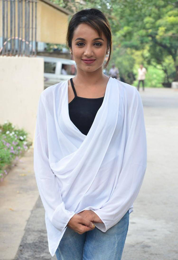 Actress Tejaswi Photos in White Shirt Blue jeans