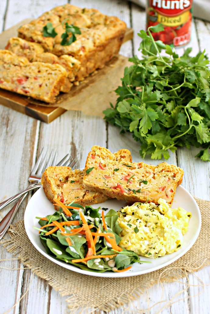 Recipe for a savory quick bread flavored with tomatoes and cheese.