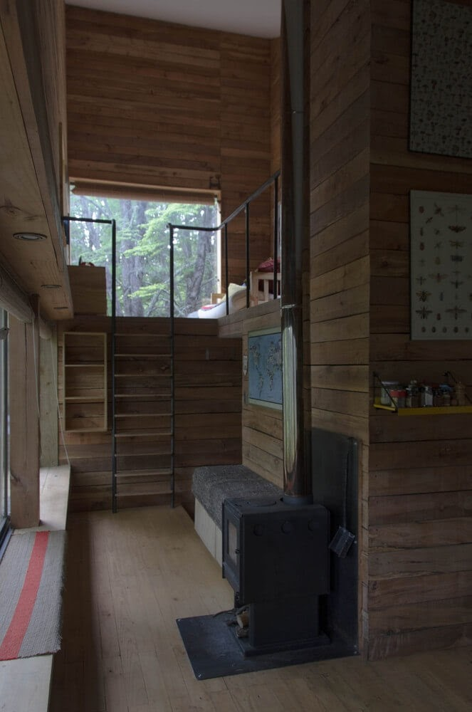02-Wood-Stove-and-Wood-Panelling-DRAA-Architects-Shangri-La-Cabin-Architecture-in-the-Woods-www-designstack-co