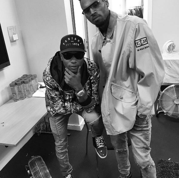 Wizkid pictured with Chris Brown ahead of show