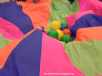 Kids Play Parachute Games with Small Balls in Middle