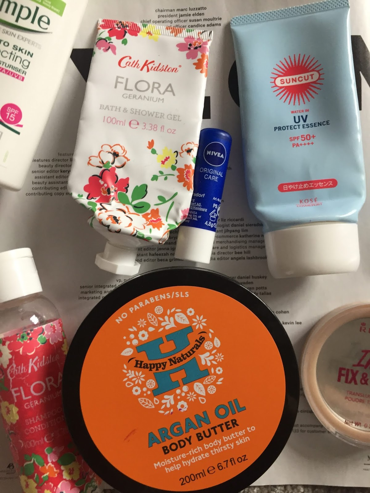 flatlay of empty beauty products including Nivea, Kosé and Cath Kidston