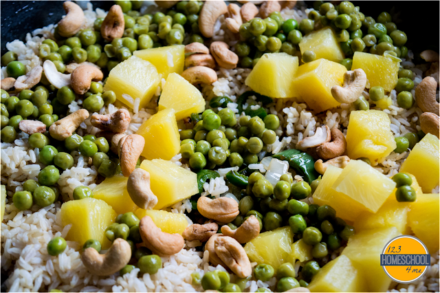 add pineapple, peas, rice, and cashews and cook thoroughly
