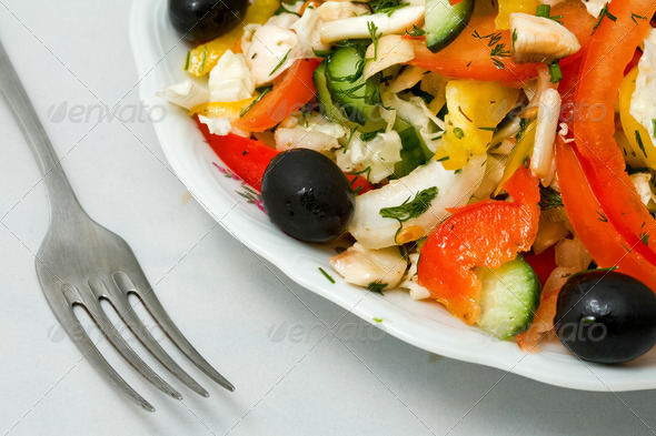 an image of fork and fresh salad on the plate