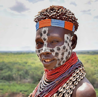 Wearing cowrie shells and glass beads a Karo Woman in Ethiopia is beautiful