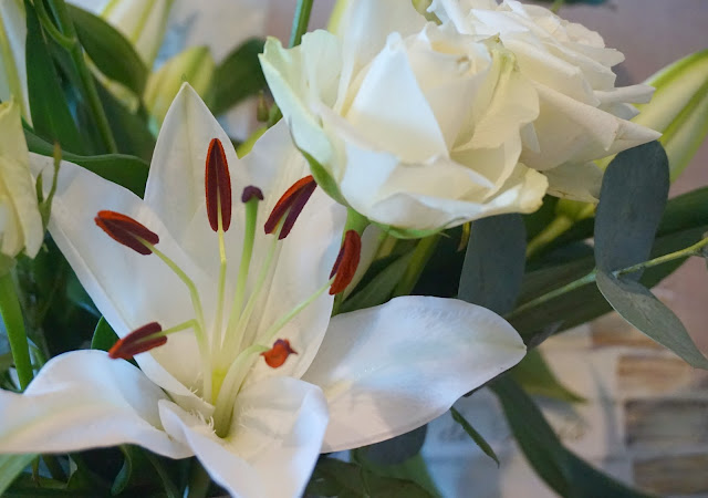 close up photo of an oriental lily and avalanche rose