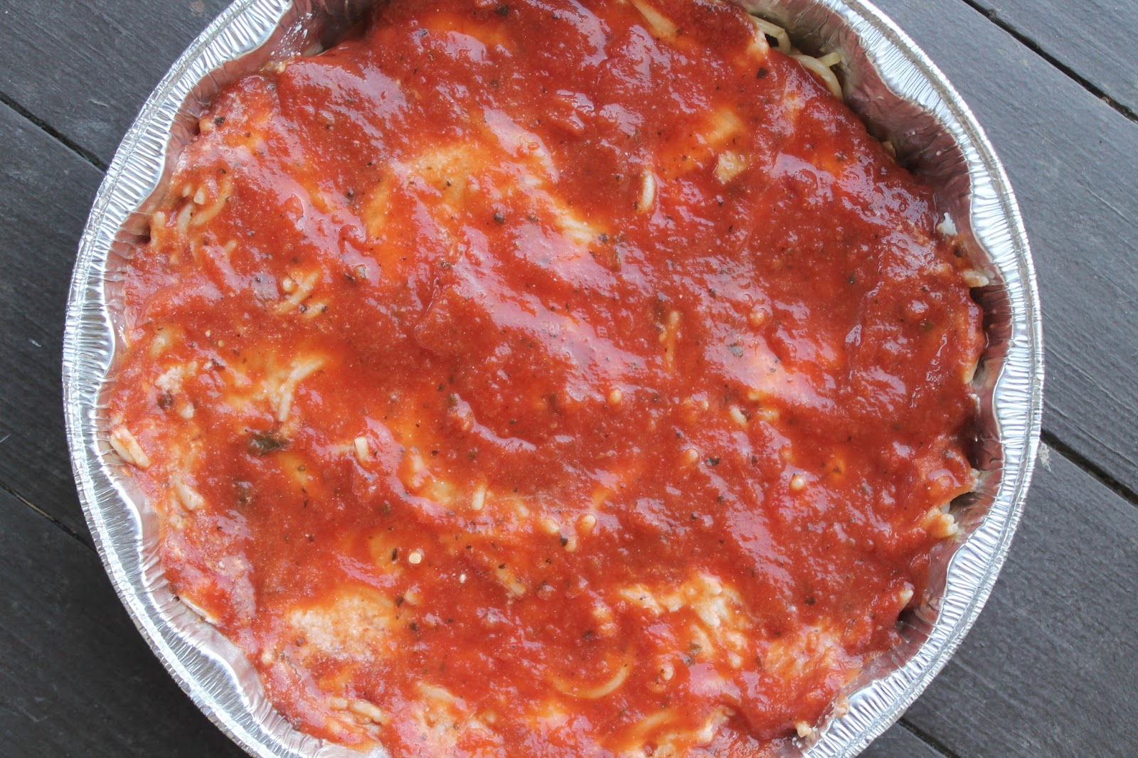 baked spaghetti with sauce in tin