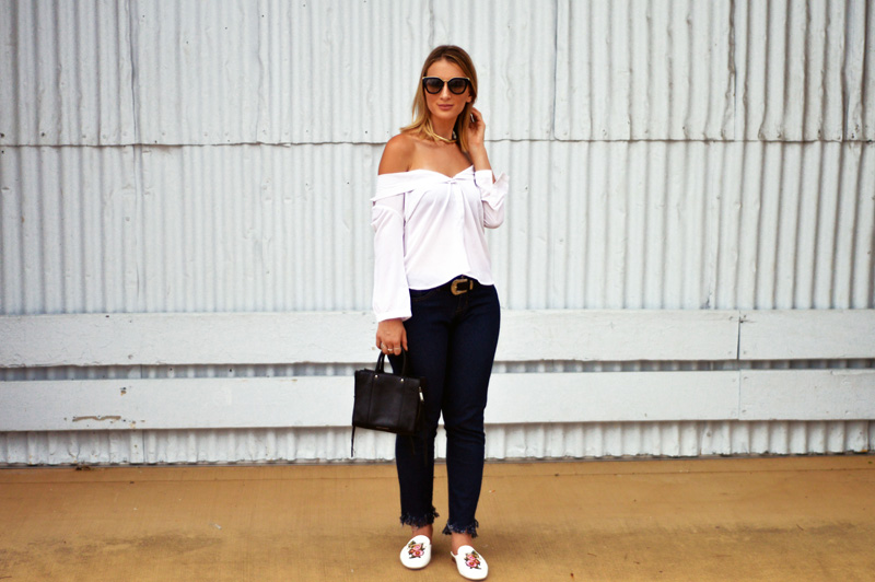 blogger street style outfit white button up shirt styled off shoulder fringe hem jeans embroidered loafers