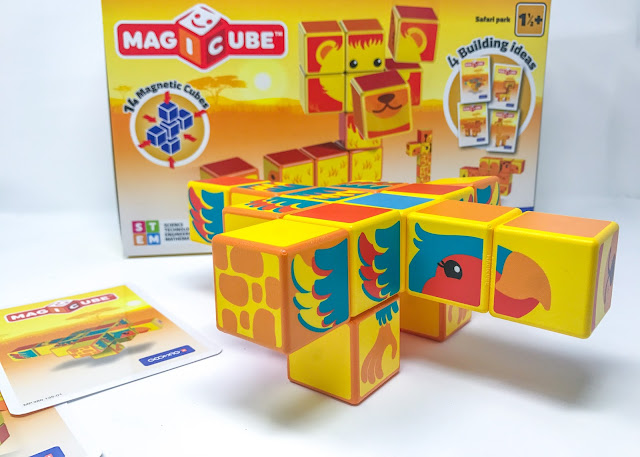 The building blocks together in the shape of a bird in front of the box and next to the instruction cards