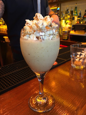 Cocktail with popcorn in it