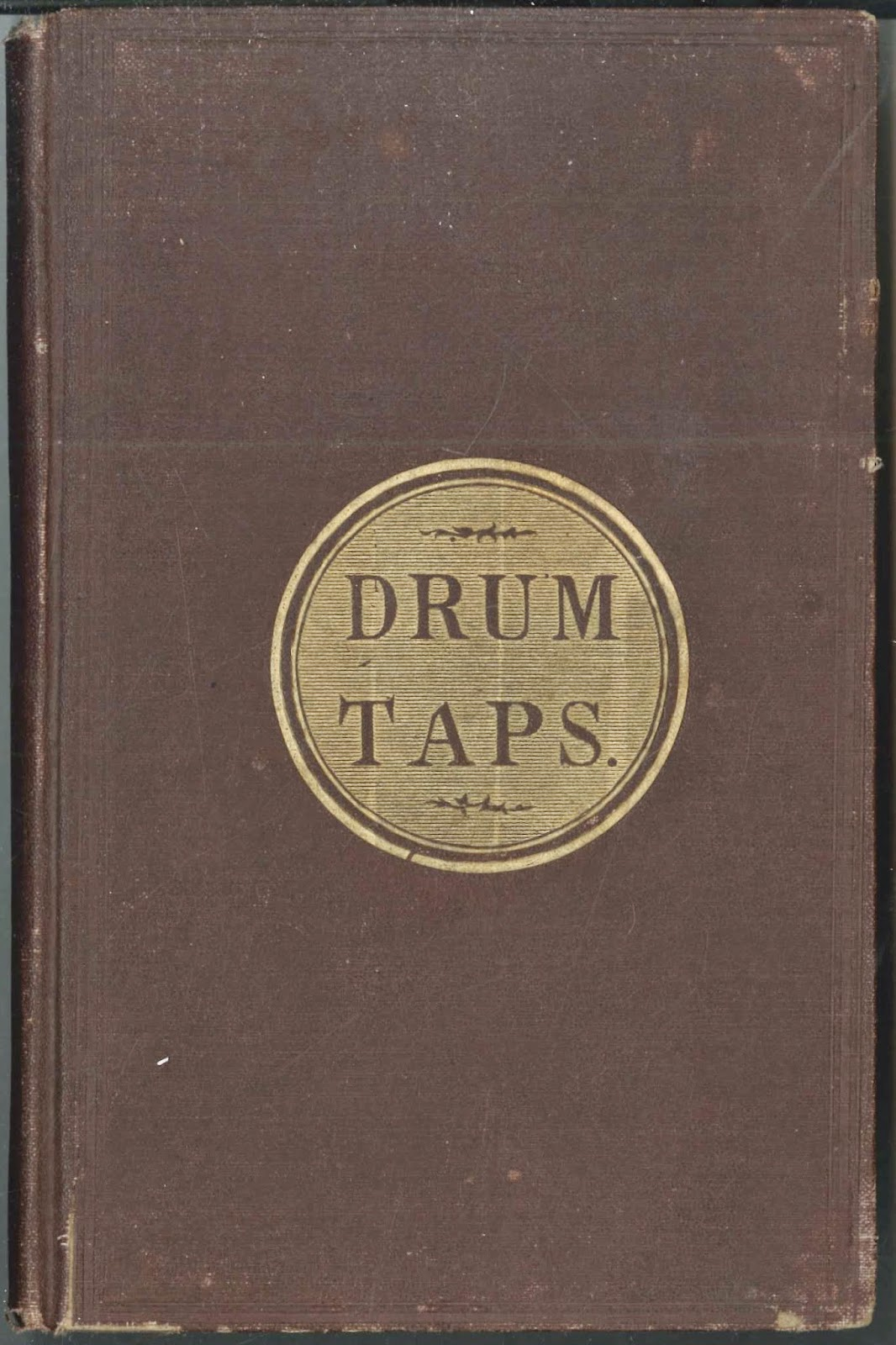 "A simple book cover for ""Drum-Taps."""