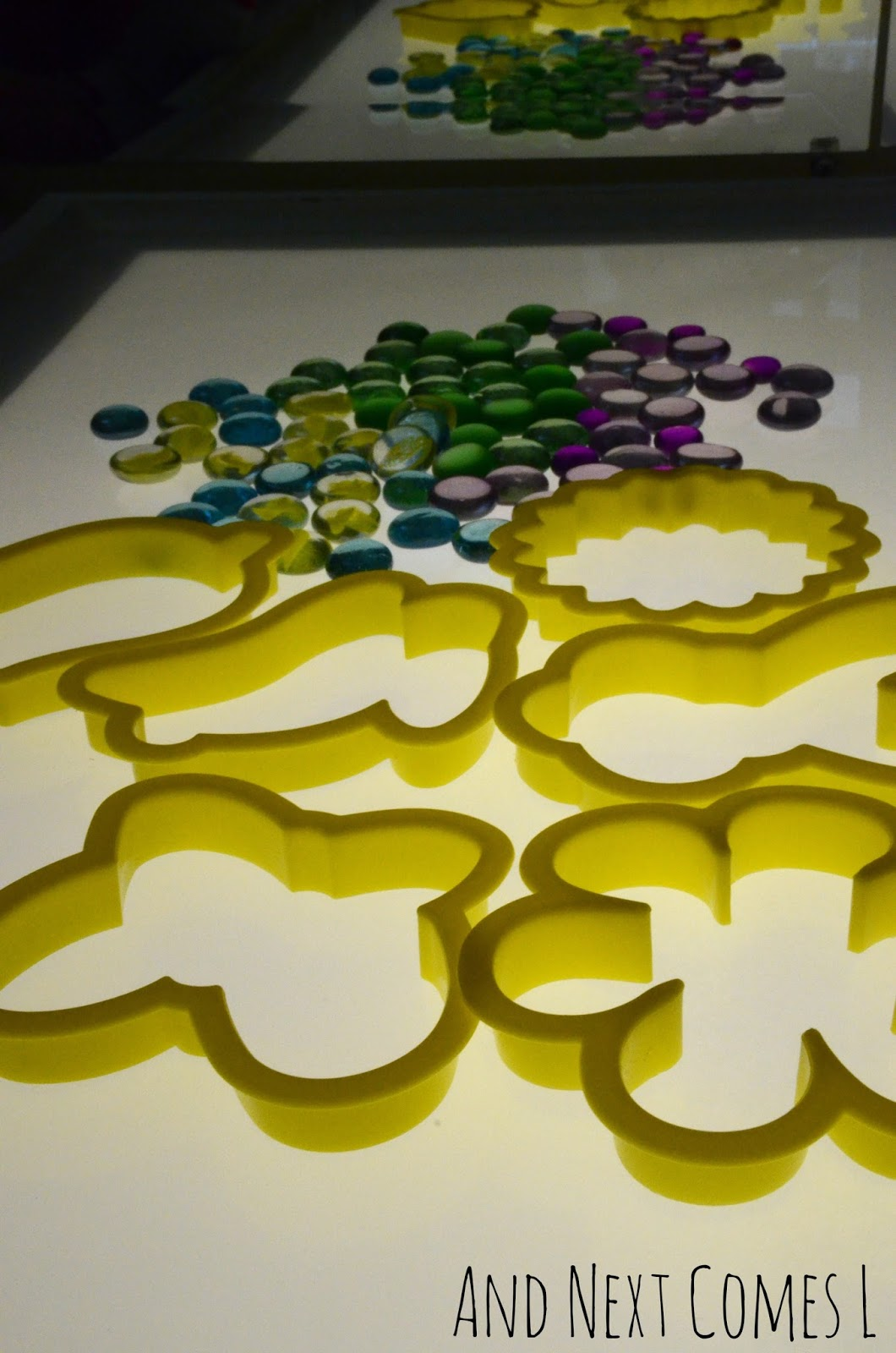 Spring and Easter cookie cutters with glass stones on the light table from And Next Comes L