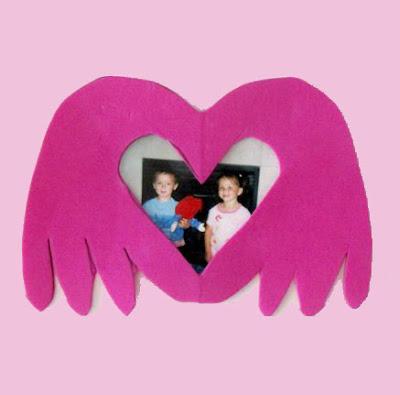 http://www.artsymamabear.com/handprint-heart-frame-valentine/