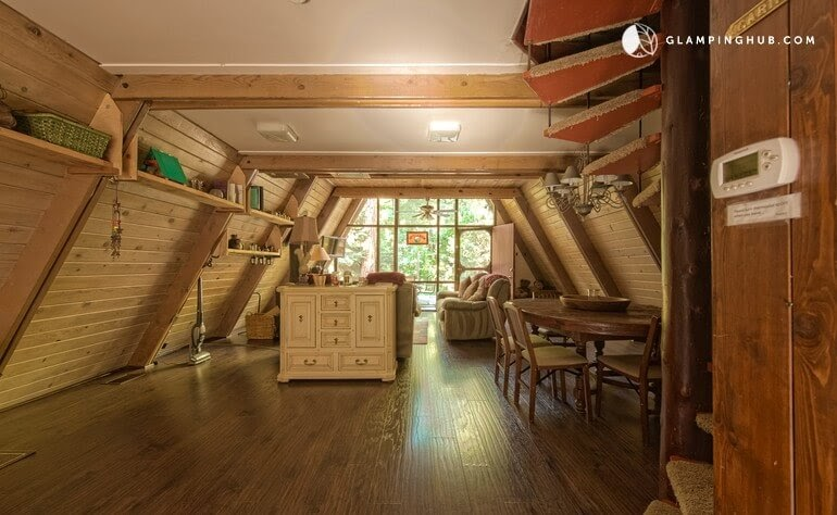05-Dining-Area-Glamping-Hub-A-Frame-House-Architecture-www-designstack-co