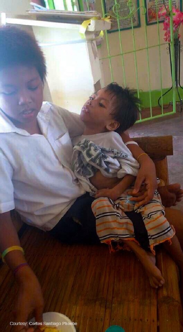 Diligent Grade 3 student cares for special child brother in school