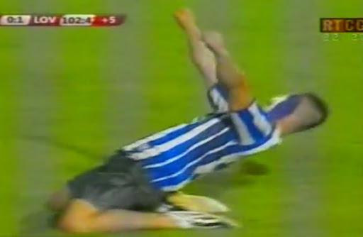 A Budućnost fan celebrates scoring a goal following a pitch invasion