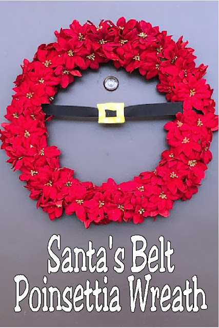 Create a beautiful and simple Santa's belt for your Christmas door with this simple DIY using ribbon, mini poinsettias, and glue.  So easy and so festive.  #santasbelt #christmaswreath #christmasdecor #poinsettia #diypartymomblog