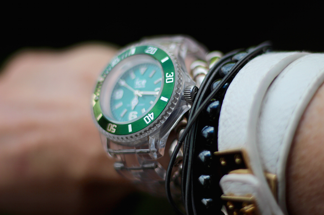 Fake Fabulous | Green Ice Watch and layered leather and hematite bracelets.