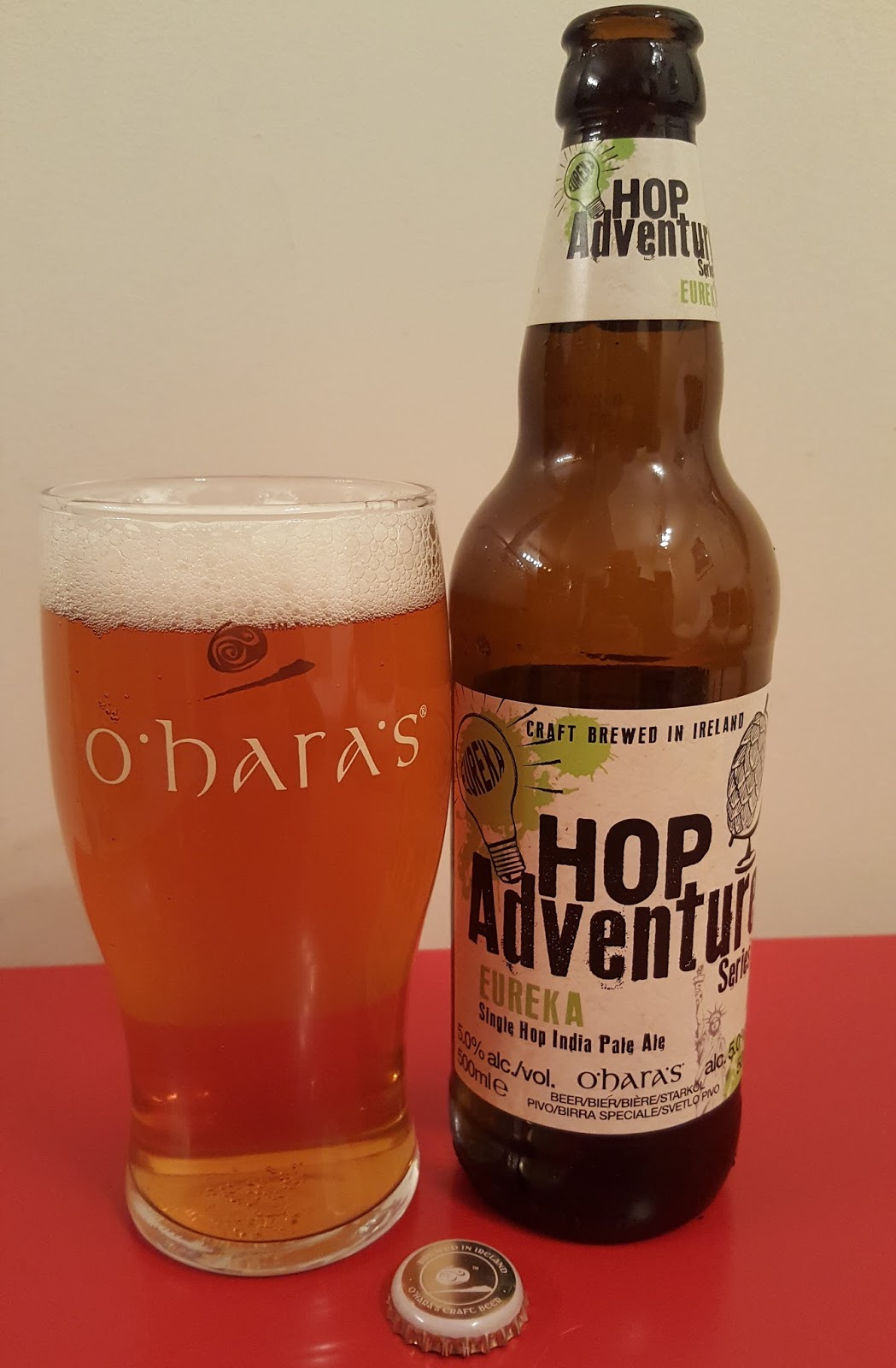 Beer 5 in the O'Hara's Hop Adventure Series arrived and the brewery kindly  sent me a bottle. Hop Adventure Eureka brings us to the US for the first  time.