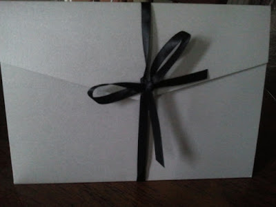 K'Mich Weddings - Wedding invitation - wedding planning - sliver with black ribbon tied in a bow