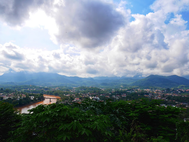 the views of Luang Prabang and surrounding areas from the top of Mount Phousi