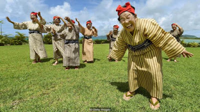 Image showing happy Japanese grandmothers from KBG84 performing at a herb garden