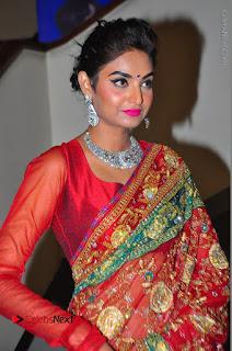 Model Sharon Fernandes Stills in Red Saree at Trendz Exhibition Launch  0036.JPG