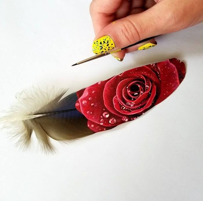12-Rose-on-a-macaw-feather-Krystle-Missildine-Painting-Realistic-Animals-on-Delicate-Feathers-www-designstack-co