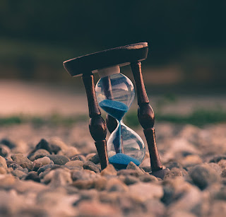 hourglass with sand running through it