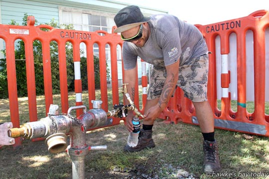 Charlie Pomana, Napier, time out from mowing lawns, getting chlorine-free water from a Napier City Council tap outside the Girl Guides Hall in Anderson Park, York Ave, Greenmeadows, Napier. photograph