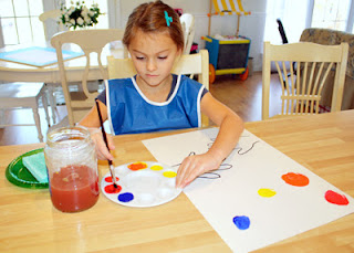 Tessa carefully mixed yellow with red to make orange, blue with red to make violet, and yellow with blue to make green.